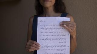 Idit Harel Segal, who donated a kidney to a Palestinian child from the Gaza Strip, holds with the letter she wrote to the boy, handwritten in Hebrew before giving him an Arabic translation