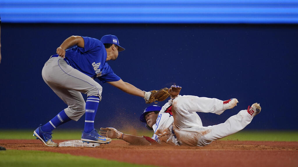 South Korea's Baekho Kang, right, is tagged out by Israel's Scott Burcham while trying to steal second in the ninth inning of a baseball game at the 2020 Summer Olympics