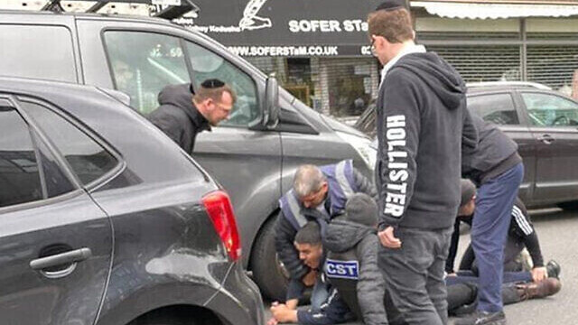 Men from the CST and Shomrim security units detain the alleged attacker of a Jewish man in his car in London, May 21, 2021