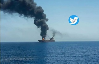 Smoke rises from the Mercer Street oil tanker attacked Friday off the coast of Oman