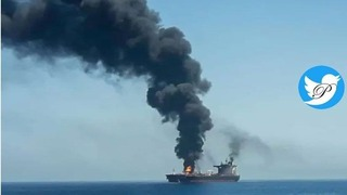 Smoke billows from a Japanese-owned oil tanker after an attack attributed to Iran off the cost of Oman