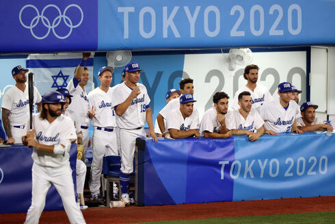 Team Israel looks on from the dugout in the bottom of the ninth inning against Team United States during the baseball opening round Group B game on day seven of the Tokyo 2020 Olympics