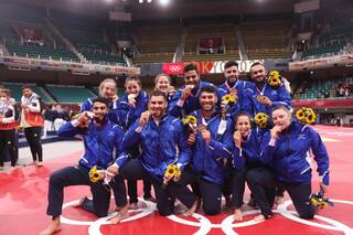 Israel's judo team show off their bronze medals at the Tokyo Olympics