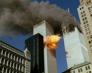United Airlines Flight 175 collides into the south tower of the World Trade Center in New York as smoke billows from the north tower