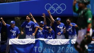 Israel players react after Danny Valencia hit a three-run home run by during a baseball game against Mexico