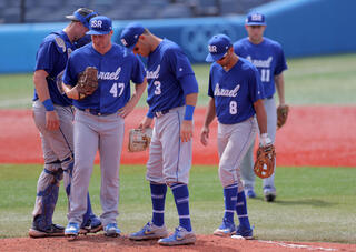 Israeli baseball team players disappointed after suffering a defeat at the hands of South Kora at the Tokyo 2020 Olympic Games