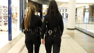 Police officers enforce virus rules at a mall in Haifa