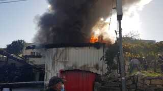 Fire rages near homes on the West Bank on Monday