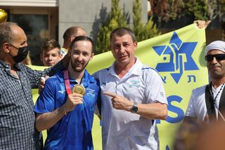 Artem Dolgopyat with his coach Sergey Weisbourg at Ben-Gurion Airport on Tuesday