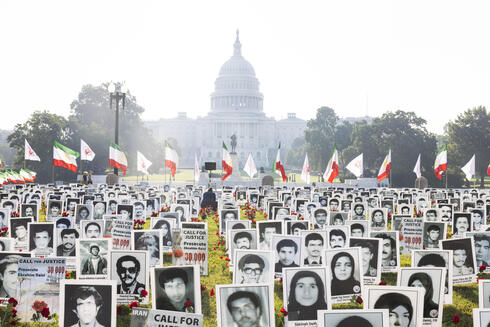 A photo exhibit created by the Organization of Iranian American Communities (OIAC), which is 'seeking the prosecution' of Iran's incoming president Ebrahim Raisi 'for crimes against humanity', outside the US Capitol in Washington, DC