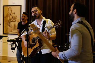 Palestinian accountant, Raji El-Jaru, sings and plays the guitar during a rehearsal for his music band Osprey V in Gaza City