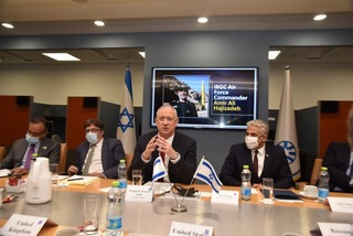 Defense Minister Benny Gantz, center, and Foreign Minister Yair Lapid, right, briefing ambassadors of countries on the UN Security Council on deadly tanker attack