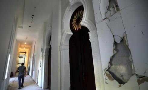 A worker walks in a corridor of the Sursock Museum that is still under reconstruction a year after being damaged in the massive explosion at the nearby port, in Beirut
