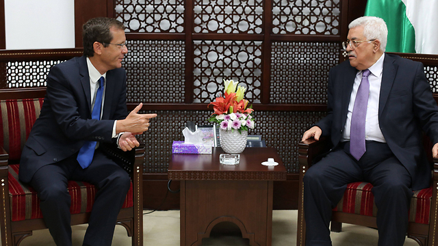 Then-opposition leader Isaac Herzog meeting with Palestinian President Mahmoud Abbas in Ramallah in 2015