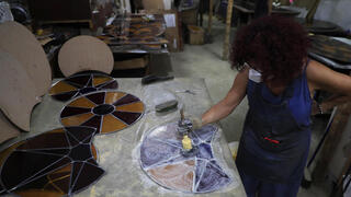 Artist Maya Hussaini works to recreate one of the stained-glass windows that were the trademark of BeirutגÄôs Sursock Museum, shattered in last yearגÄôs port explosion, at her studio in Beirut