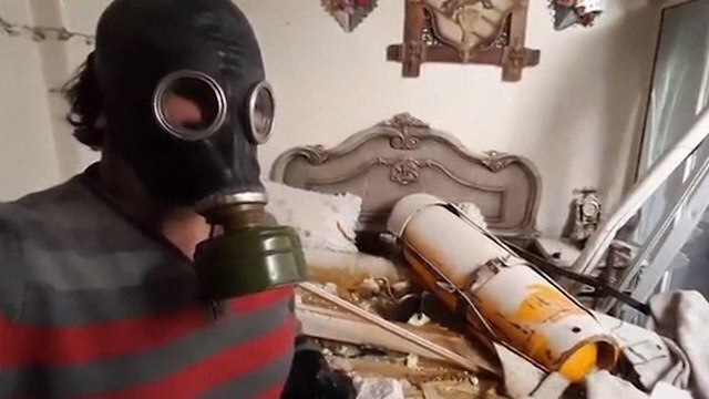 A man showing an alleged chemical  armament used at the bombardment of Douma