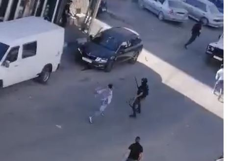 Members of the Jabari clan shooting in the streets of Hebron, in July