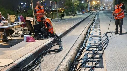 ElectReon workers laying electric cables have been fitted underneath Tel Aviv