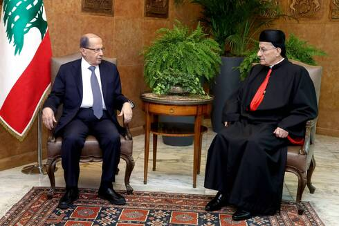 Lebanese President Michel Aoun (left) meets with Lebanon's Cardinal Mar Bechara Boutros al-Rai, the Maronite Patriarch of Antioch and the Whole Levant, at the Presidential Palace in Baabda