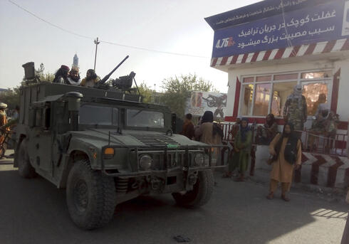 Taliban fighters after taking control of Kunduz city in Afghanistan on Monday