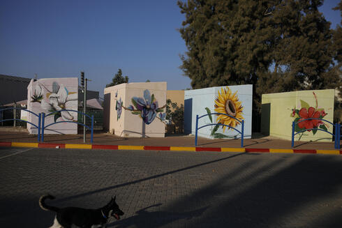 Small concrete bomb shelters painted in bright colors for children waiting for their school bus, in Sderot, Israel, July 28, 2021