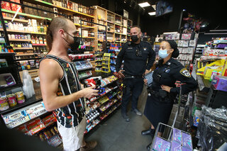 Police officers enforcing coronavirus restrictions at a local business