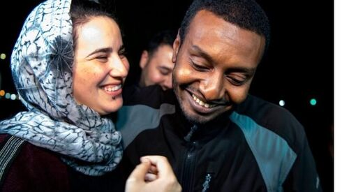 Moroccan journalist Hajar Raissouni is greeted by her boyfriend Rifaat Al Amine upon leaving prison after being granted a royal pardon in 2019