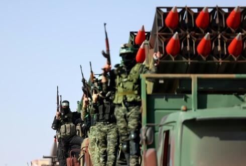 Hamas militants display their rocket arsenal during a parade in the Gaza Strip shortly after a ceasefire ended 11 days of deadly conflict with Israel