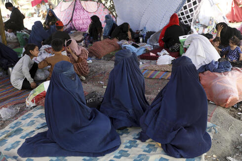 Refugees from Taliban-controlled areas sleep in a park in Kabul