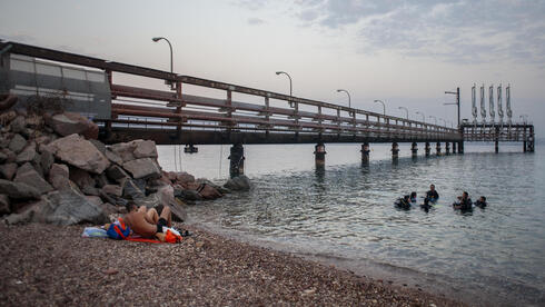 A group of scuba divers prepares to exit the water after diving in the Red Sea near t the Europe-Asia Pipeline Company (EAPC) oil jetty in Israel's southern city of Eilat, Thursday, Aug, 5. 2021