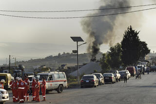 Smoke rises from the site of a fuel truck explosion in northern Lebanon on Sunday