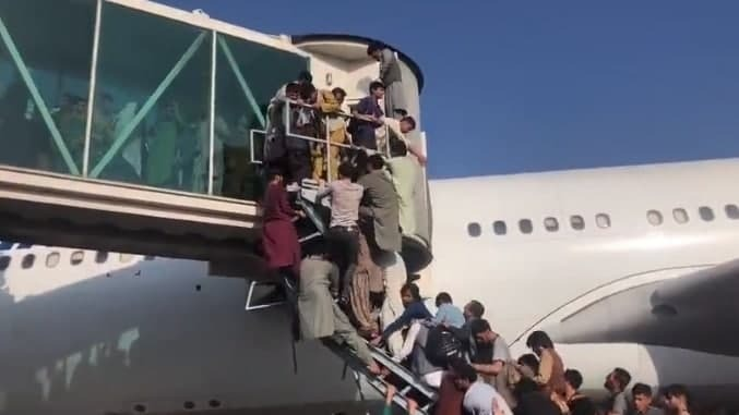 Afghans attempt to board planes to escape the country on Monday