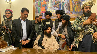 Members of the Taliban in the presidential palace in Kabul after President Ashraf Ghani fled, August 15, 2021
