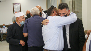 Justice Minister Gideon Saar embraces the family of slain friend and political ally Sahar Ismail on Monday