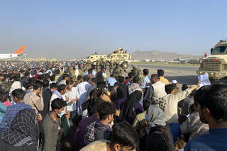 Afghans at Kabul airport trying to board a flight out of the country