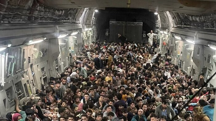 People cram into aircraft leaving Afghanistan amid U.S. pullout in August