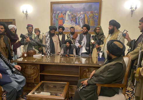 Taliban fighters after taking control of the Presidential Palace in Kabul last week