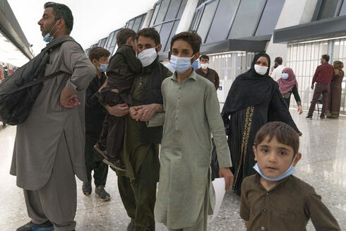 An Afghan family evacuated from Kabul at Washington's Dulles Airport on Sunday