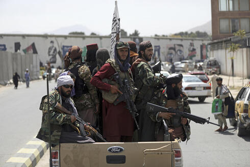 Taliban fighters in Kabul on Thursday