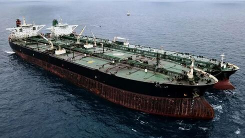 A seized Iranian tanker and Panamanian vessel suspected of illegally transferring oil in Indonesian waters on January 24, 2021.