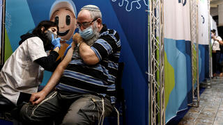 A man receives his third dose of the coronavirus disease (COVID-19) vaccine in Jerusalem, August 15, 2021