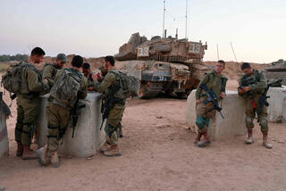 IDF troops resting at a military outpost near Gaza Strip border