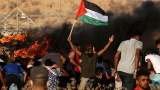 Palestinians rioting along the Gaza border fence, August 2021