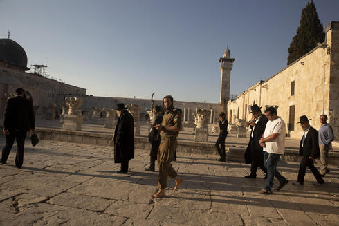 Religious Jews arrive to pray at the Temple Mount in the Old City of Jerusalem, Monday, Aug. 2, 2021
