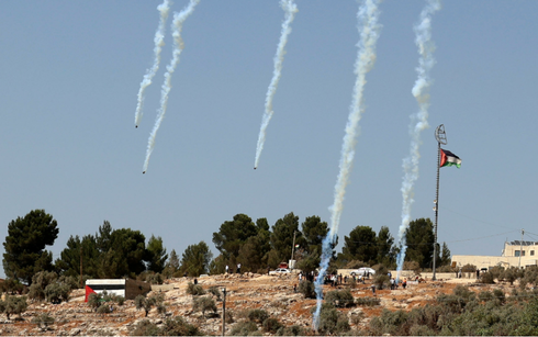 Israeli forces fire tear gas as Palestinians in Beita protest against the Eviatar outpost on August 20, 2021