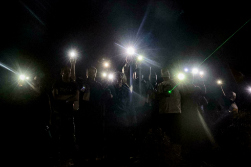 Palestinians use their phones to protest in Beita against the Eviatar outpost