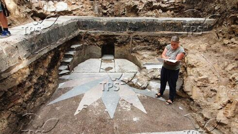 An Israeli archeologist at site of  the Torah Ark from a synagogue destroyed during the Holocaust