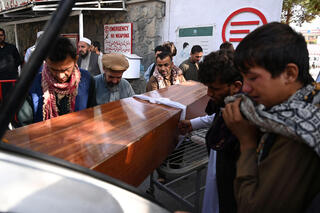 Mourners carrying a coffin of a victim killed in the terror attack on Kabul airport last week
