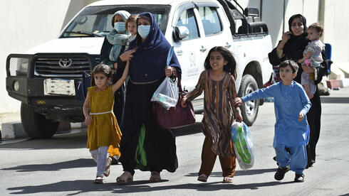 Afghani family trying to escape Kabul