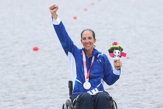 Moran Samuel celebrates after winning silver in the women's 2,000-meter single sculls at the Tokyo 2020 Paralympic Games on Sunday